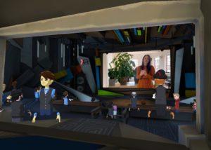 Kollegin Claudia als Moderatorin auf der Bühne eines virtuellen Events!